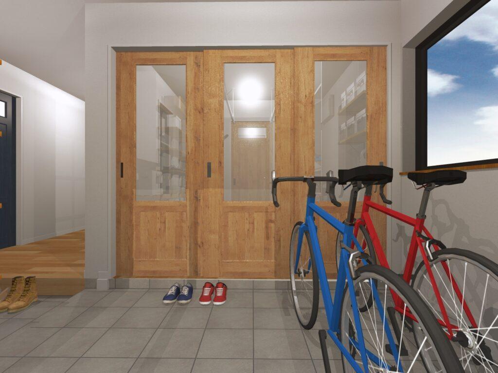 お気に入りの自転車の向こうは家事室。動線も良好です。